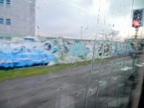 Lightly streaks of rain as the train moves out of Christchurch